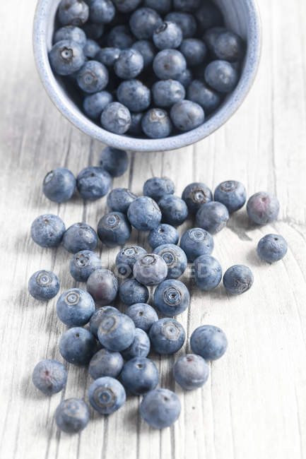 Blueberries falling out of bowl — Stock Photo
