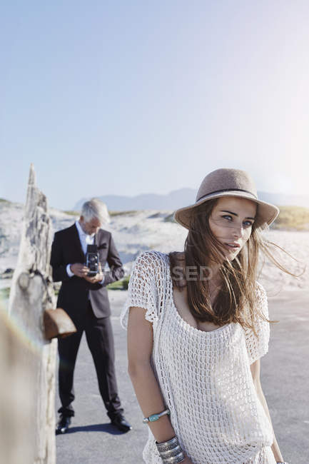 South Africa, Cape Town, portrait of young model with photographer on background — Stock Photo