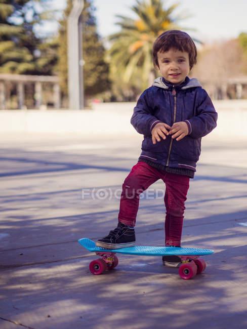 Portrait of little boy with skateboard — Stock Photo