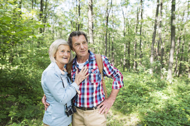 Happy cute senior couple hugging together at park — Stock Photo