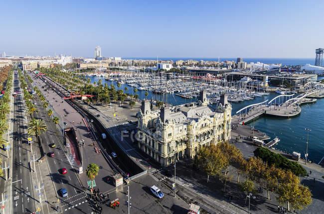Spain, Barcelona, cityscape as seen from Columbus column with marina — Stock Photo
