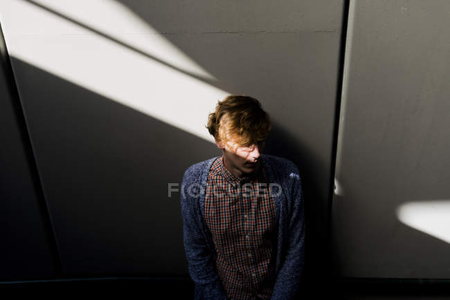 Young man between shadow and light — Stock Photo