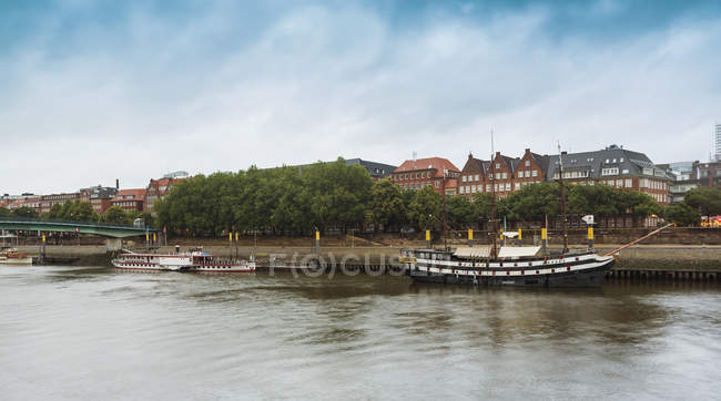Germany, Bremen, on the River Weser, Schlachte, view of town against water — Stock Photo