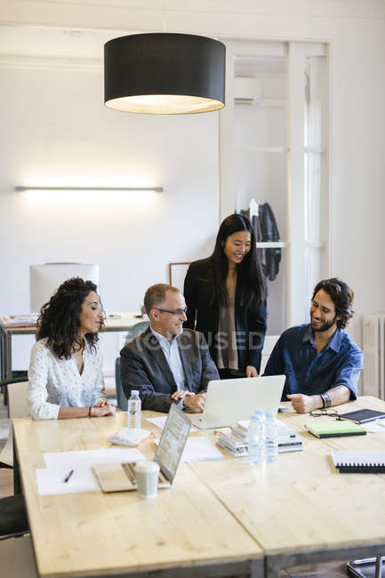 Business people having a meeting in office — Stock Photo