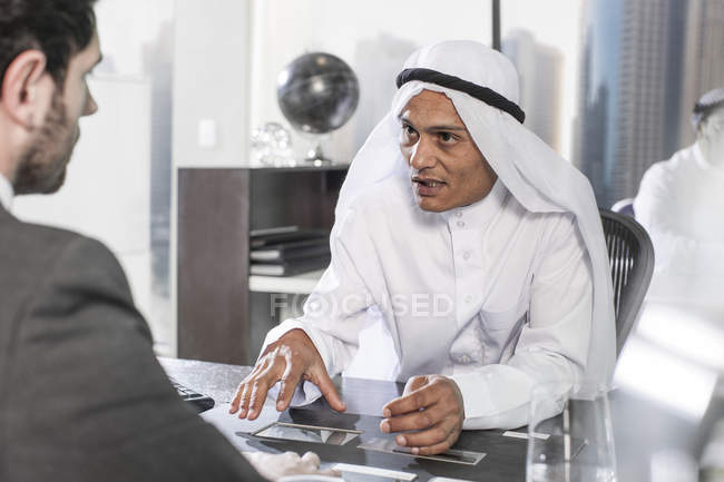 Businessman having meeting in Middle Eastern office — Stock Photo