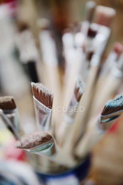 Paint brushes in a studio, close-up — Stock Photo