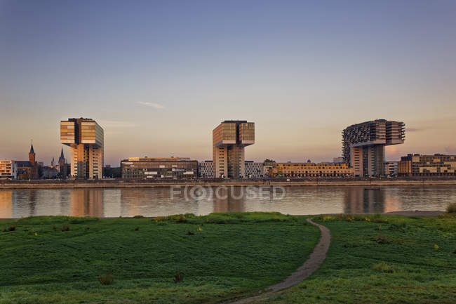 Germany, Cologne, view to Crane Houses at Rhine harbour at evening twilight — Stock Photo