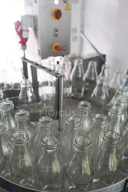 Empty glass bottles in a bottling plant — Stock Photo