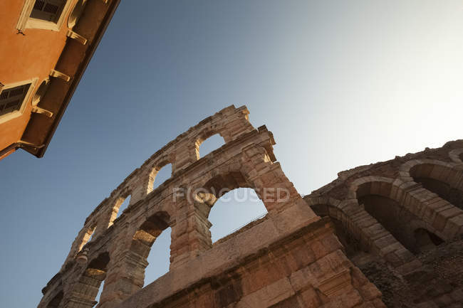 Italy, Tuscany, tilted view of ancient building against sky — Stock Photo