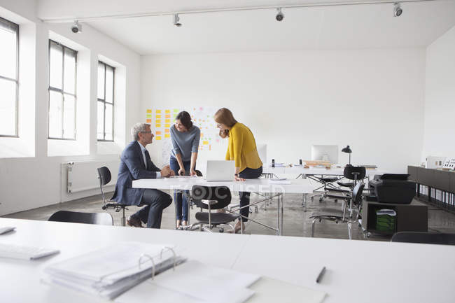 Businessman and two women in office having a meeting — Stock Photo