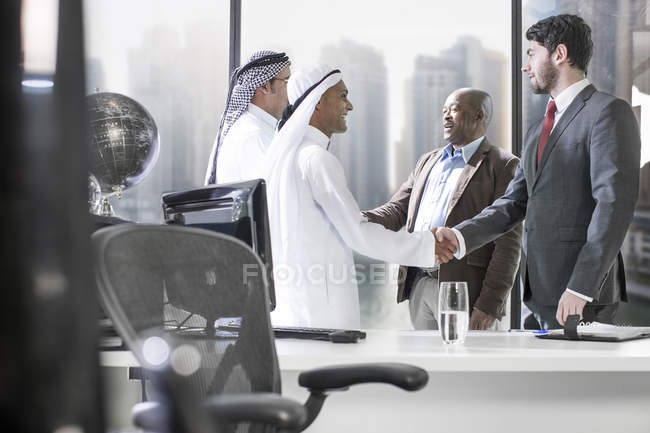 Western businessmen having meeting in Middle Eastern office — Stock Photo