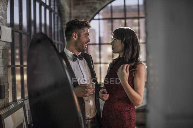 Couple wearing elegant clothing with champagne glass — Stock Photo