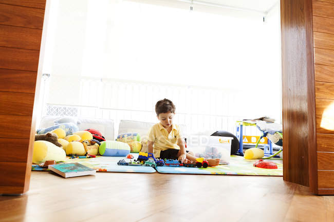 Little boy playing on floor in the children room — Stock Photo