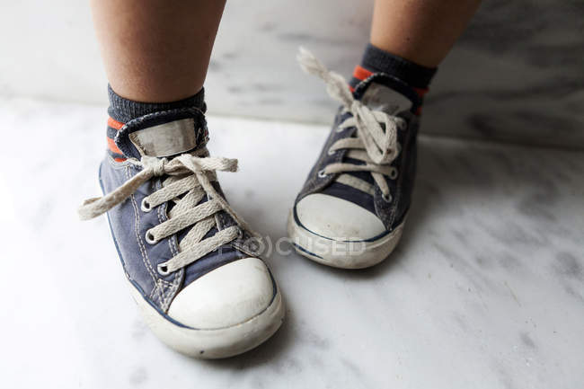 Close-up of boy wearing sneakers — Stock Photo