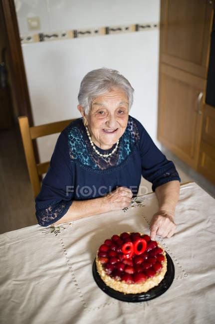 Senior woman celebrating her ninetieth birthday — Stock Photo