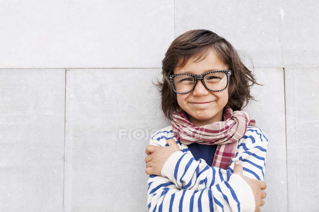 Portrait of grinning little boy wearing scarf and oversized glasses — Stock Photo