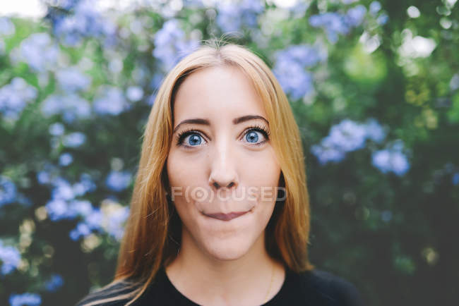 Portrait of a blond woman pulling faces — Stock Photo