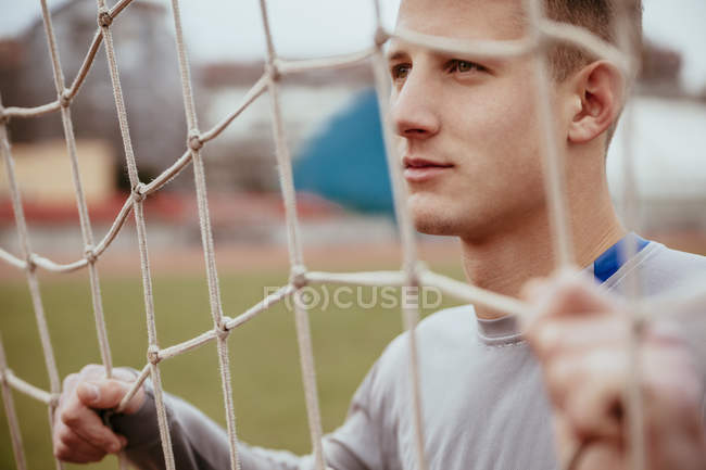 Young man in soccer goal — Stock Photo