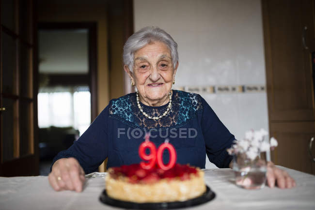 Portrait of senior woman celebrating her ninetieth birthday — Stock Photo