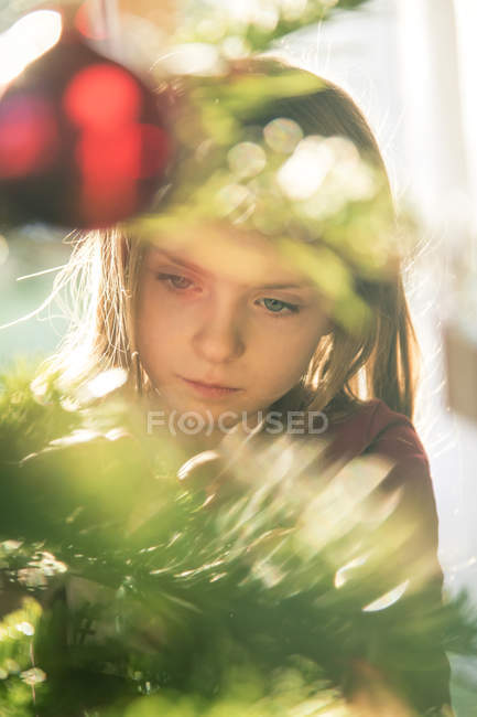 Portrait of girl decorating Christmas tree — Stock Photo