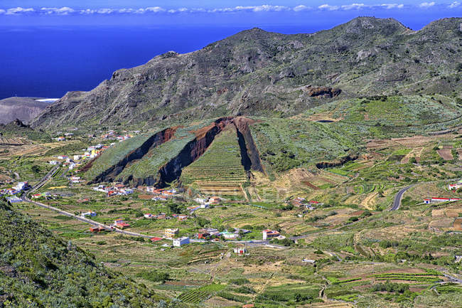 View of El Palmar valley and a hill that has been dug away for topsoil, Tenerife, Canary Islands, Spain — Stock Photo