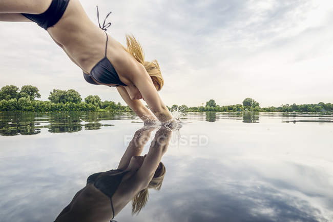 Woman jumping into water — Stock Photo
