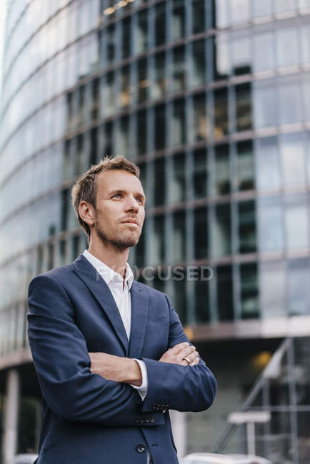 Portrait of handsome businessman with arms crossed — Stock Photo