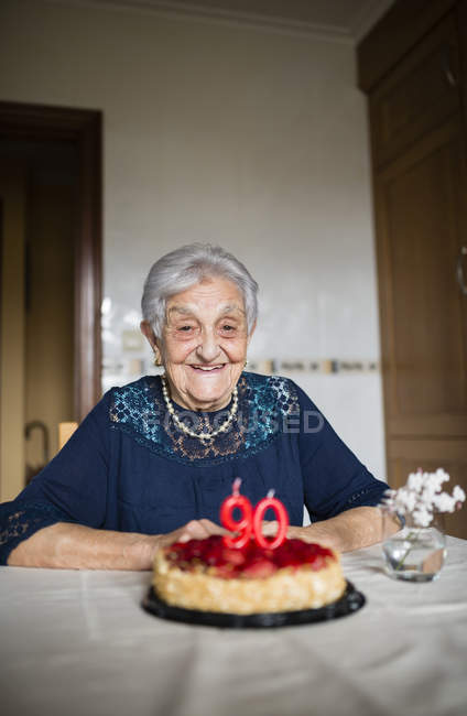 Portrait of happy senior woman celebrating her ninetieth birthday — Stock Photo