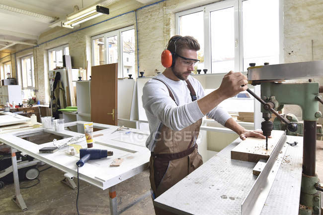 Carpenter at work in his workshop — Stock Photo