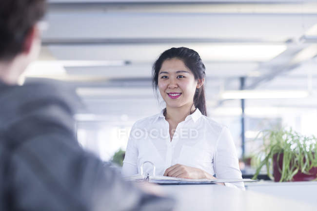 Chinese office worker working in customer service — Stock Photo