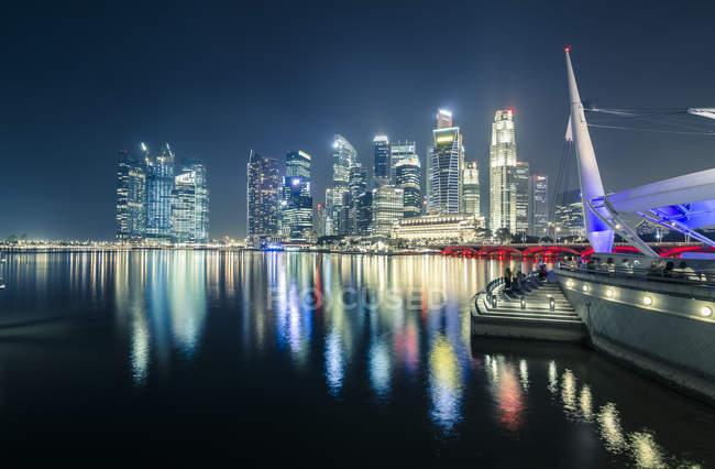 Skyline of Singapore illuminated at night — Stock Photo