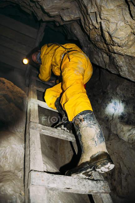 Bolivia, Potosi, tourist wearing protective clothing visiting the Cerro Rico silver mine — Stock Photo