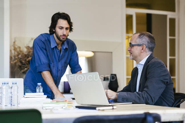 Two businessman working together in office — Stock Photo