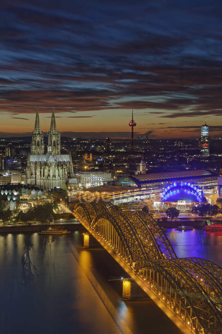 Germany, Cologne, view to the lighted city at evening twilight — Stock Photo