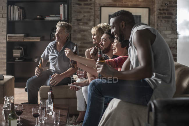 Friends together having fun watching TV — Stock Photo