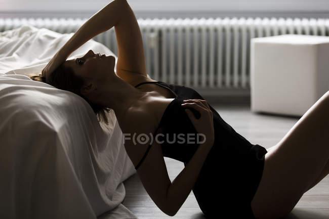 Sensual woman in lingerie in bedroom — Stock Photo