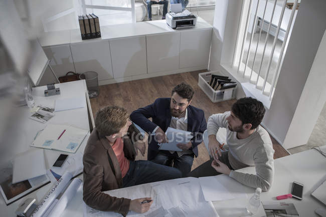 Three men in office working together — Stock Photo