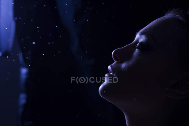 Side view of Face of woman in the darkness — Stock Photo