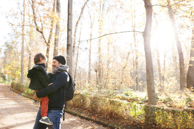 Father and son in autumn landscape — Stock Photo