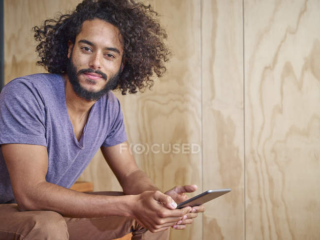 Portrait of young man holding digital tablet — Stock Photo
