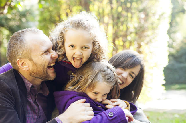Parents and their little daughters having together — Stock Photo