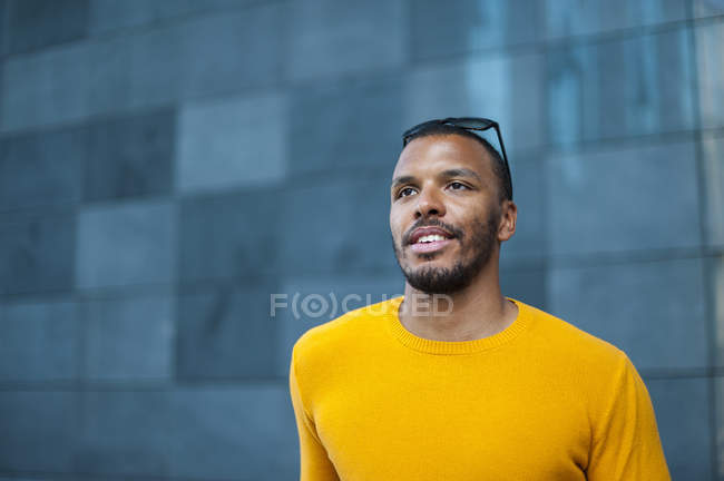 Portrait of smiling man wearing yellow pullover — Stock Photo