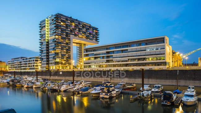 Germany, Cologne, Rheinauhafen, marina and Kranhaus at blue hour — Stock Photo