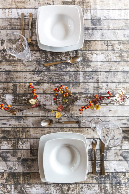 Two place settings on autumnal decorated table — Stock Photo