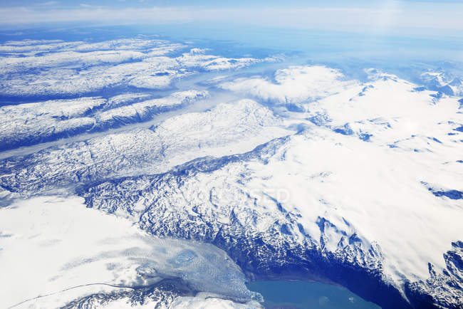 Greenland, view out of plane window on glaciers, fjords, sea and mountains — Stock Photo