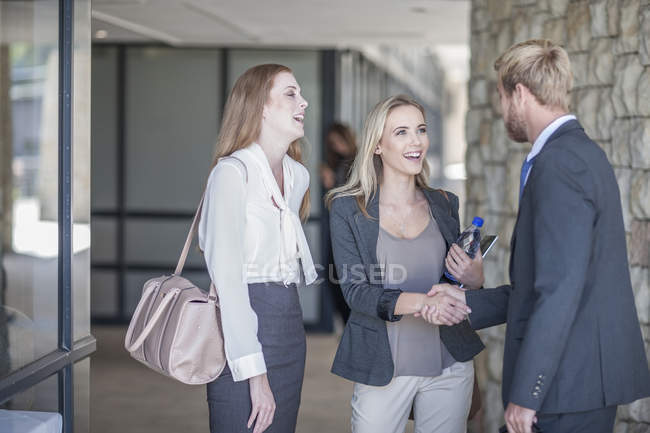 Young business people having an informal meeting — Stock Photo