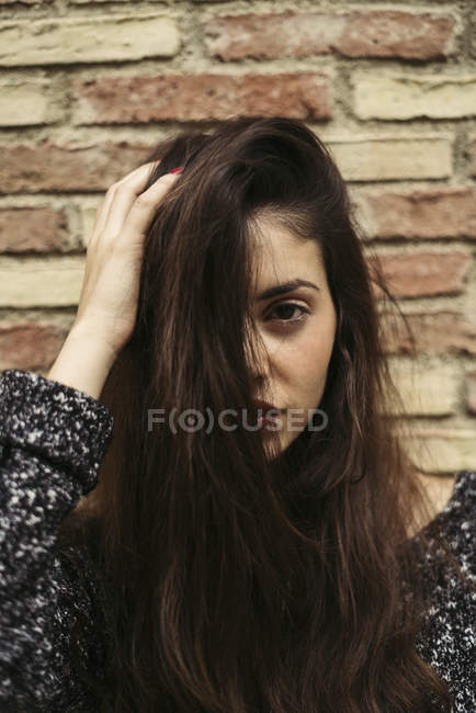 Portrait of young woman with long brown hair — Stock Photo