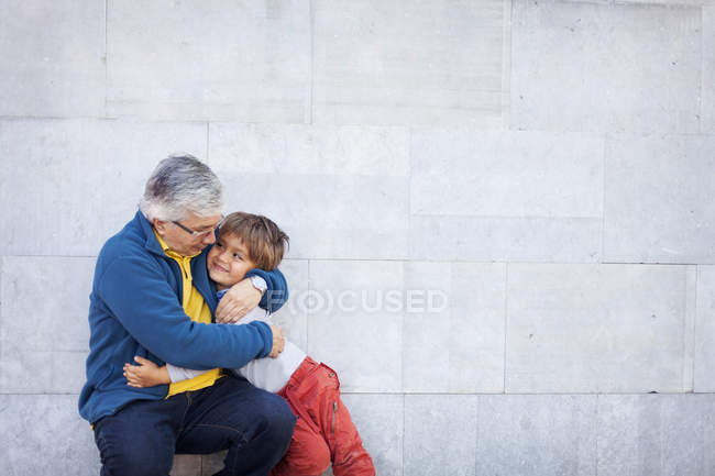 Grandfather and grandson hugging each other — Stock Photo