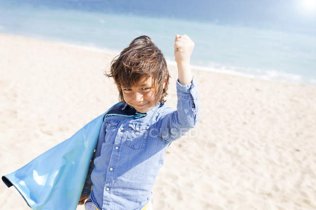 Portrait of little boy with blue cape playing superhero — Stock Photo