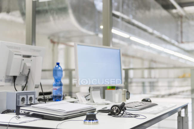 Working desk with pc in fabric — Stock Photo